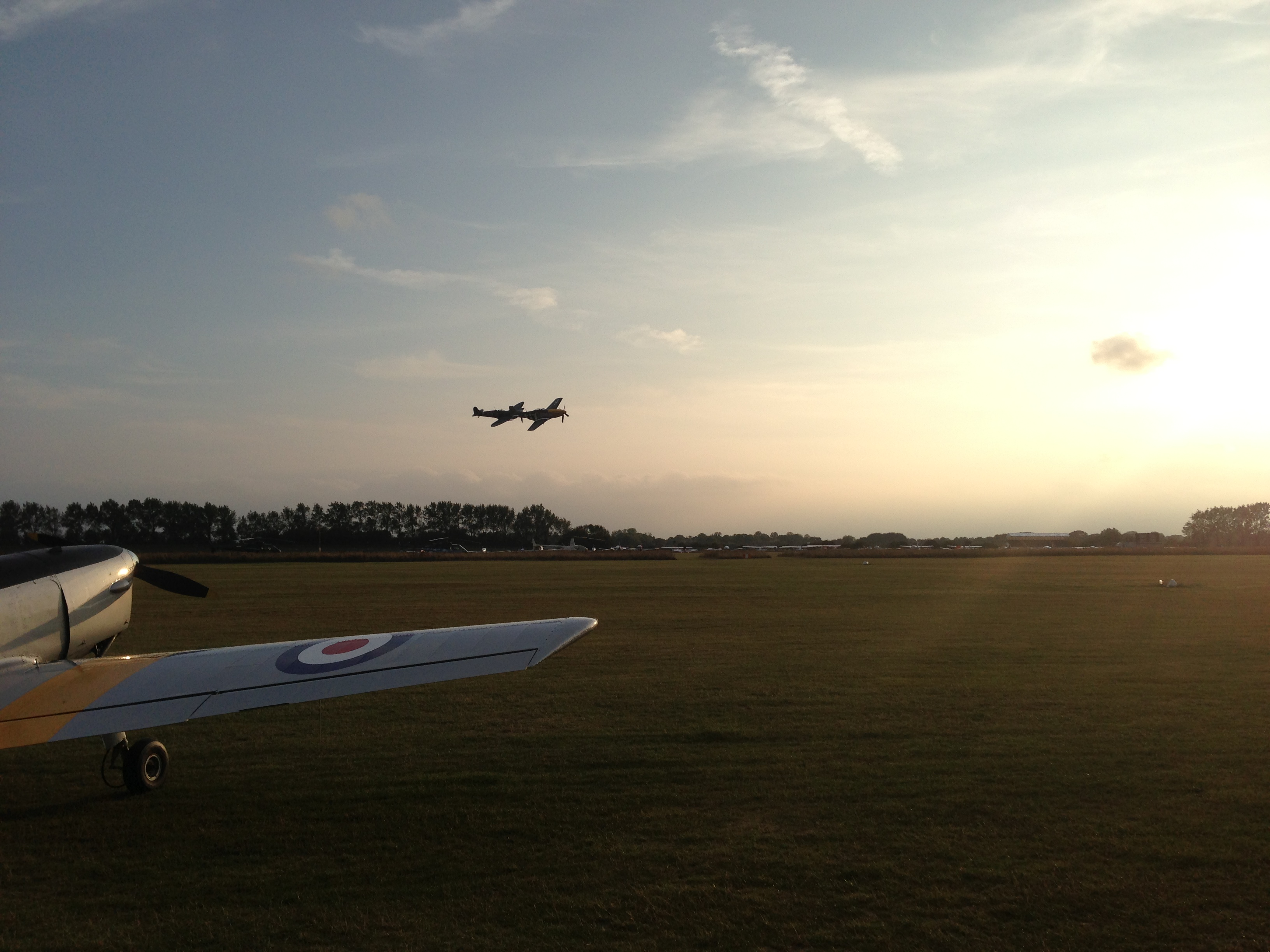 Two Spitfires above Goodwood airfield